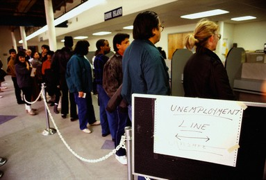 February 1992, Providence, Rhode Island, USA --- Unemployed people wait in a long line at the unemployment office in Providence. --- Image by © Joel Stettenheim/CORBIS